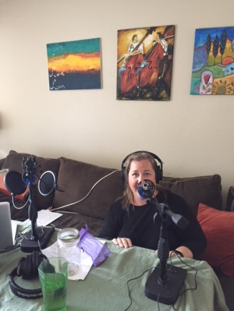 Kym on the mic, ready to podcast!